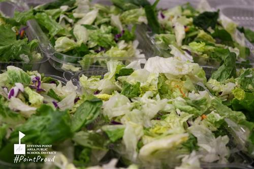 lettuce being used in salads for students at the school